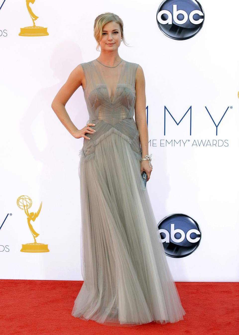 Actress Emily VanCamp arrives at the 64th Primetime Emmy Awards at the Nokia Theatre on Sunday, Sept. 23, 2012, in Los Angeles.  (Photo by Jordan Strauss/Invision/AP)
