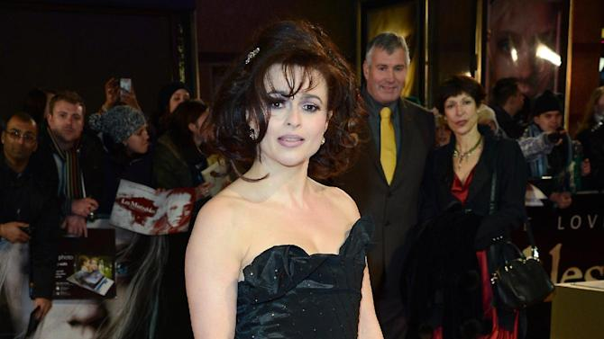 """FILE - In this Wed., Dec. 5, 2012 file photo, Helena Bonham Carter poses for photographers as she arrives at the film premiere of """"Les Miserables"""" at a cinema in central London. A report from Ancestry.com says Victor Hugo was a political colleague of a cousin of the 46-year-old actress. Carter stars as Madame Thenardier in the upcoming musical """"Les Miserables."""" (Photo by Jon Furniss/Invision/AP, File)"""