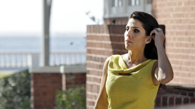 Jill Kelley leaves her home Monday, Nov 12, 2012 in Tampa, Fla. Kelley is identified as the woman who allegedly received harassing emails from Gen. David Petraeus' paramour, Paula Broadwell. She serves as an unpaid social liaison to MacDill Air Force Base in Tampa, where the military's Central Command and Special Operations Command are located.(AP Photo/Chris O'Meara)