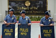 Philippine policemen stand guard in front of the US embassy in Manila on September 26. The United States has issued a security alert for the Philippine capital, warning its citizens they could be the target of an unspecified attack