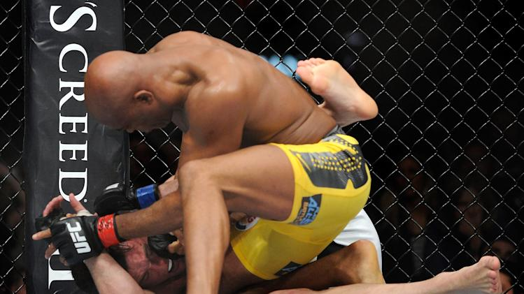 Anderson Silva and Chael Sonnen battle it out during their UFC 148 middleweight championship fight at the MGM Grand Garden Arena Saturday, July 7, 2012 in Las  Vegas. Silva won with a TKO in the second round. (AP Photo/David Becker)
