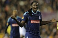 Stoke City&#39;s forward Kenwyne Jones is pictured in February 2012. Stoke and Fulham were the biggest casualties in the League Cup second round on Tuesday as the Premier League clubs slumped to shock defeats against Swindon and Sheffield Wednesday respectively