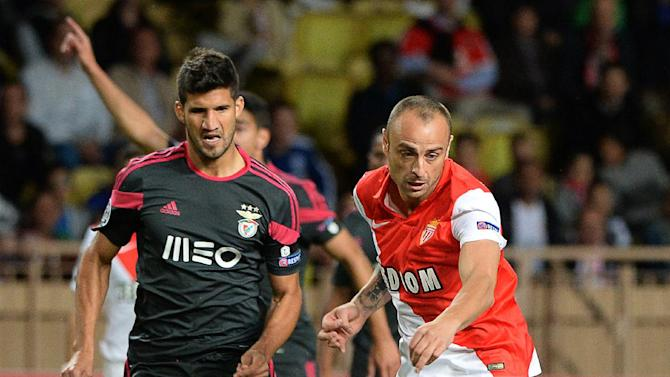 Monaco's Dimitar Berbatov (right) injured his thigh 11 minutes before half-time in the Champions League match against Benfica at the Louis II Stadium in Monaco, on October 22, 2014