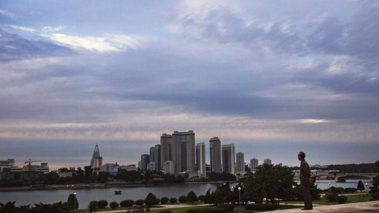In this Sept. 13, 2012 photo, a man looks across the river at central Pyongyang, North Korea. (AP Photo/David Guttenfelder)