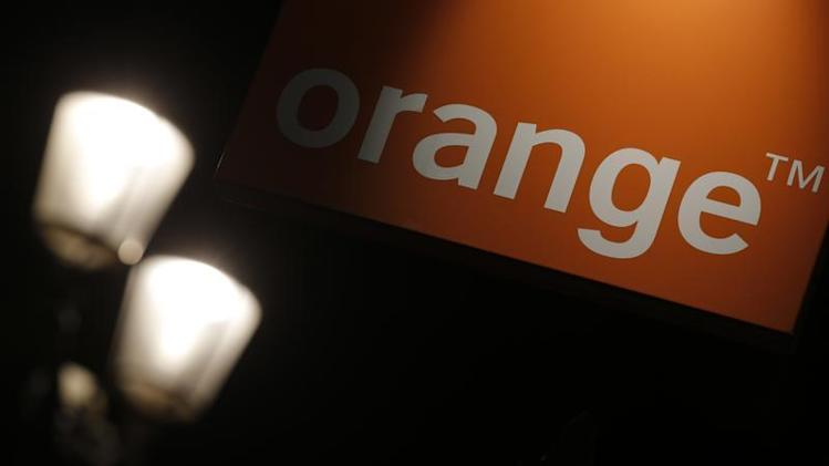 The logo of the Orange telecommunication and internet provider is seen on the facade of a store in Paris