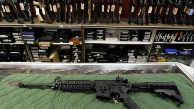 An AR-15 style rifle is displayed at the Firing-Line indoor range and gun shop in Aurora, Colo.
