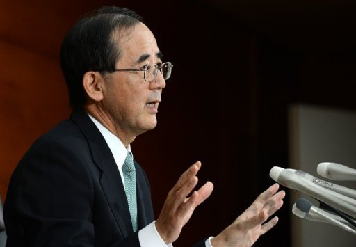 <p>Bank of Japan governer Masaaki Shirakawa gestures at a news conference in Tokyo on Tuesday. The Bank of Japan has unveiled $138 bn in fresh monetary easing, its latest volley in a battle to kickstart an economy it warned would grow much less than previously expected.</p>
