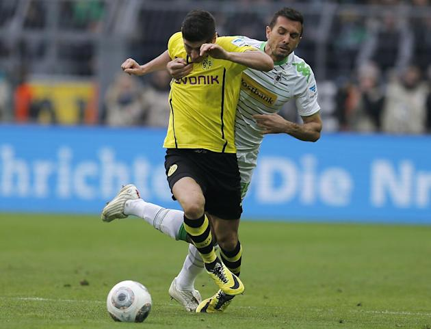 Dortmund's Robert Lewandowski of Poland, front, and Moenchengladbach's Martin Stranzl of Austria challenge for the ball during the German first division Bundesliga soccer match between BvB Bor