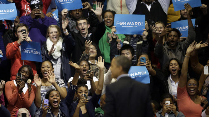 Supporters react to seeing President Barack Obama onstage during a campaign event at Fifth Third Arena, Sunday, Nov. 4, 2012, in Cincinnati. (AP Photo/Pablo Martinez Monsivais)