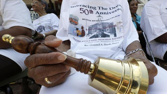 "Jeanne Smiley of Montgomery, Ala., holds her bell during ceremonies honoring the 50th anniversary of the Martin Luther King Jr., ""I Have a Dream"" speech in Montgomery, Ala., Wednesday, Aug. 28, 2013. The ceremony took place outside the Dexter Ave. King Memorial Baptist Church where King became pastor in 1954. Smiley said ""Rev. King was a great man who helped make this country a better place to live."" (AP Photo/Dave Martin)"