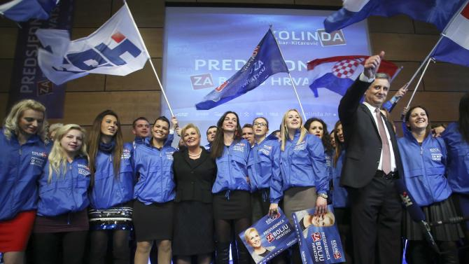 Presidential candidate of  HDZ party Kolinda Grabar-Kitarovic and president of HDZ Tomislav Karamarko celebrate with her supporters after unofficial results in Zagreb