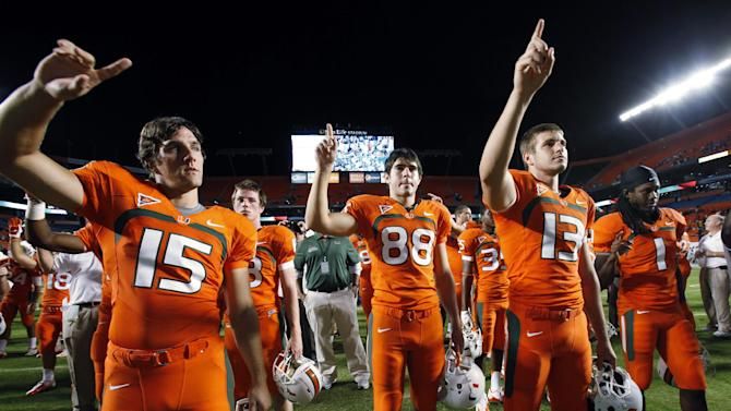 Miami players sing their alma mater as they celebrate their 40-9 win over South Florida in an NCCA college football game, Saturday, Nov. 17, 2012 in Miami. (AP Photo/Wilfredo Lee)