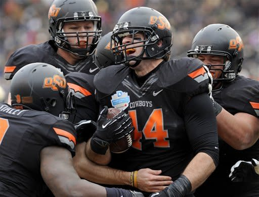 Oklahoma St rolls Purdue in Heart of Dallas Bowl