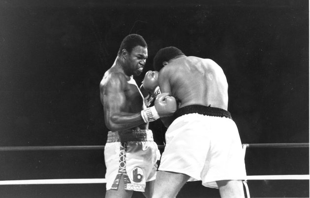 FILE - World heavyweight champion Larry Holmes, left, pounds challenger Muhammad Ali in the corner during championship fight in Las Vegas, Nev., in this Oct. 2, 1980 file photo. Holmes won when Ali failed to answer the bell to start the 11th round. (AP Photo, File)