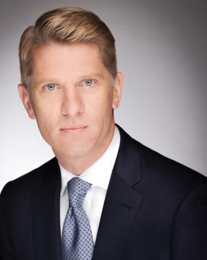 This undated photo provided by Turner shows Chairman and CEO of Turner Broadcasting System, Inc., John Martin. The corporate parent of CNN, TNT and TBS on Tuesday, Aug. 26, 2014, offered voluntary buyouts to 600 veteran employees, part of an overall cost-cutting effort at the Atlanta-based broadcasting company founded by Ted Turner. Martin has been talking for several months about a restructuring plan he has called Turner 2020. (AP Photo/Turner)