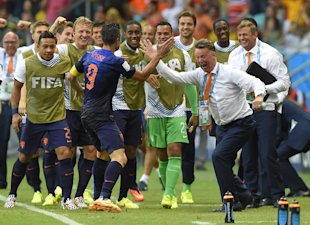 Robin van Persie (left) celebrates with Netherlands coach Louis van Gaal. (AP)