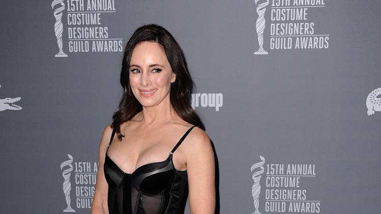 Madeleine Stowe arrives at the 15th Annual Costume Designers Guild Awards at The Beverly Hilton Hotel on Tuesday, Feb. 19, 2013 in Beverly Hills. (Photo by Jordan Strauss/Invision/AP)