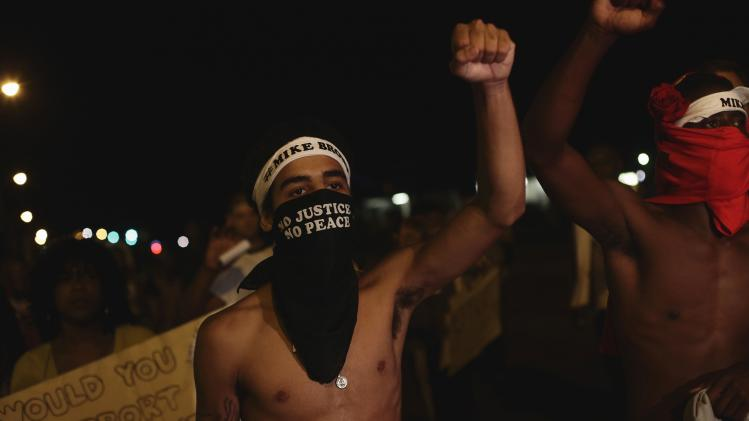 Demonstrators protest the shooting death of Michael Brown, in Ferguson, Missouri