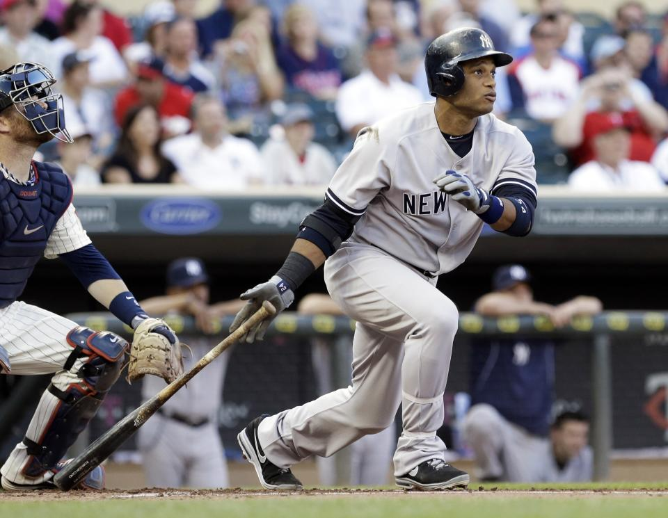 New York Yankees' Robinson Cano watches his single off Minnesota Twins pitcher P.J. Walters in the first inning of a baseball game on Wednesday, July 3, 2013, in Minneapolis. (AP Photo/Jim Mone)