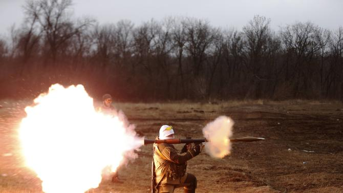 A volunteer of the separatist self-proclaimed Donetsk People's Republican guard fires a rocket-propelled grenade (RPG) during shooting training in Donetsk