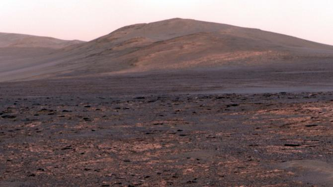 "This image provided by NASA shows a panoramic view from NASA's Mars Exploration rover Opportunity of ""Solander Point."" The space agency said Friday June 7, 2013, the six-wheel, solar-powered rover is driving to a new spot in Endeavour Crater after spending 20 months at a site brimming with evidence of water-altered rocks. Opportunity began the trip to its next destination, Solander Point, several weeks ago so that it can be in place well before the next Martian winter. (AP Photo/NASA)"