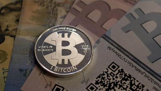 One of Bitcoin enthusiast Mike Caldwell's coins in this photo illustration at his office in Sandy, Utah, September 17, 2013. REUTERS/Jim Urquhart/Files