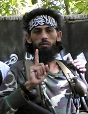 FILE - In this 2007 file photo obtained by the Associated Press from a Philippine security official, Indonesian militant Umar Patek addresses fellow militants in an Abu Sayyaf mountain encampment on Jolo island in southern Philippines. A top anti-terrorism official said Wednesday, Aug. 10, 2011, Pakistan will extradite Patek, a key suspect in the 2002 Bali bombings that killed 202 people, to Indonesia by the end of the month. Patek had a $1 million bounty on his head when he was captured in the Pakistani town of Abbottabad Jan. 25, four months before Osama bin Laden was killed there in a U.S. commando attack. (AP Photo/File) NO SALES, EDITORIAL USE ONLY