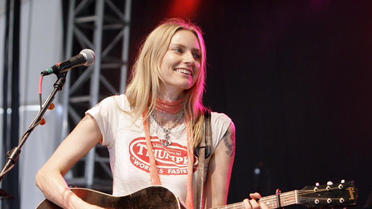 """FILE - This June 15, 2008 file photo shows Aimee Mann at the Bonnaroo music festival in Manchester, Tenn. Mann has a new song born of her experience riding out this week's superstorm in a Brooklyn hotel. Called """"Sandy"""" and sung to the tune of Barry Manilow's """"Mandy,"""" the humorous song cheered a storm-weary concert audience in New York's Westchester County Thursday, Nov. 1, 2012. (AP Photo/Mark Humphrey, file)"""