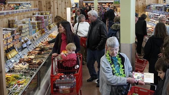 Shoppers look over the offerings at the new Trader Joe's store in Boulder