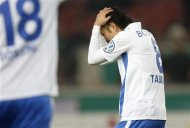 Vfl Bochum's Yusuke Tasaka reacts during their German soccer cup (DFB Pokal) quarter final match against VfB Stuttgart in Stuttgart February 27, 2013. REUTERS/Lisi Niesner