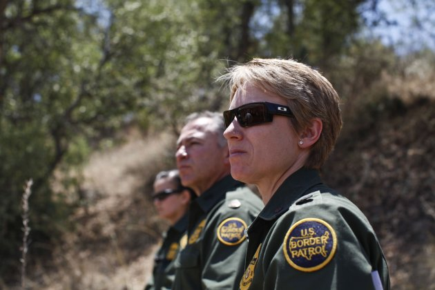 Border Patrol Agents watch their specialized unit, Border Patrol's Search, Trauma, and Rescue (BORSTAR) team as they demonstrate a technical rescue extraction of a patient off the side of a cliff in P