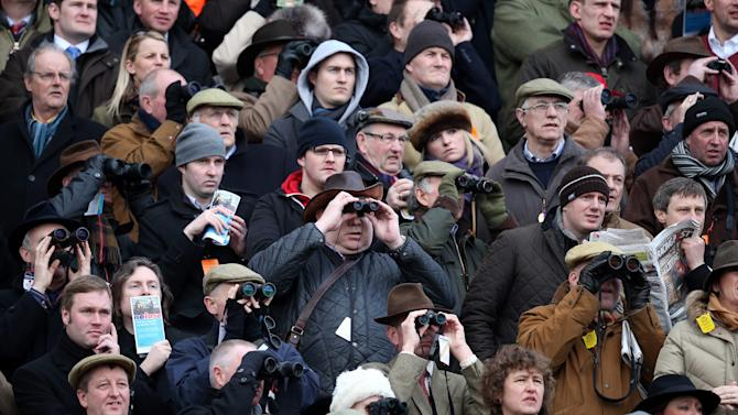Visitors Enjoy The Racing At The Cheltenham Festival 2013