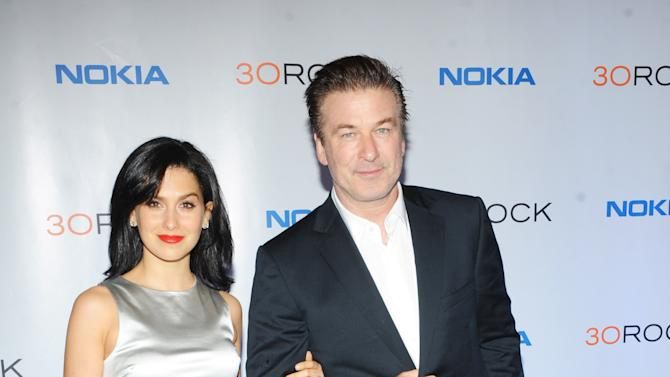 "Hilaria Thomas, left, Alec Baldwin attend the Nokia ""30 Rock"" wrap party on Thursday, Dec. 20, 2012 in New York. (Photo by Scott Gries for Nokia/AP Images)"