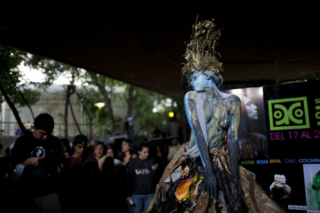 A woman covered in body paint …