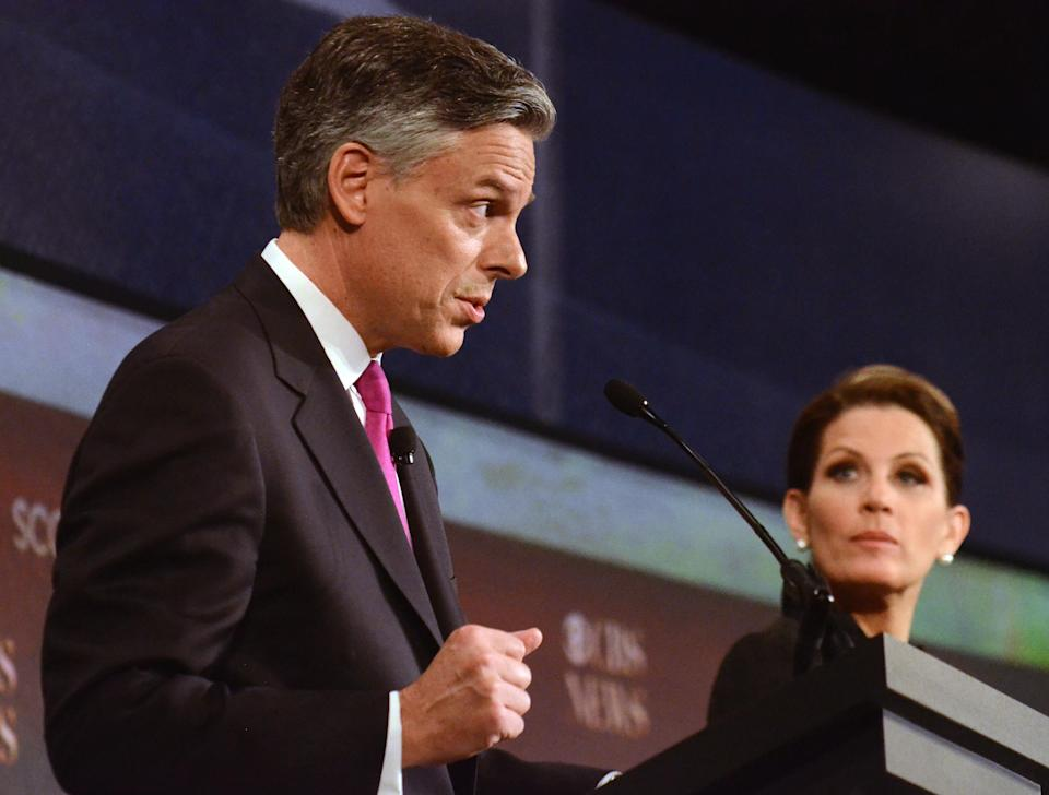 Republican presidential candidates Jon Huntsman,  left, speaks as Michele Bachmann,  looks on during the the CBS News/National Journal foreign policy debate at the Benjamin Johnson Arena, Saturday, Nov. 12, 2011 in Spartanburg, S.C. (AP Photo/Richard Shiro)