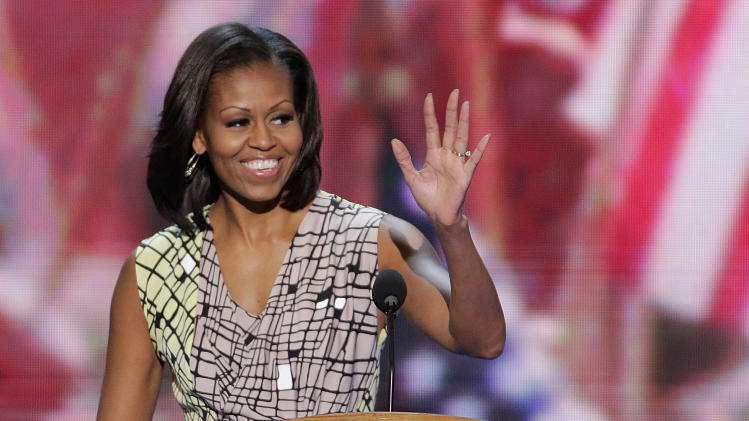 First Lady Michelle Obama waves from the podium during a sound check at the Democratic National Convention in Charlotte, N.C., on Monday, Sept. 3, 2012. (AP Photo/J. Scott Applewhite)