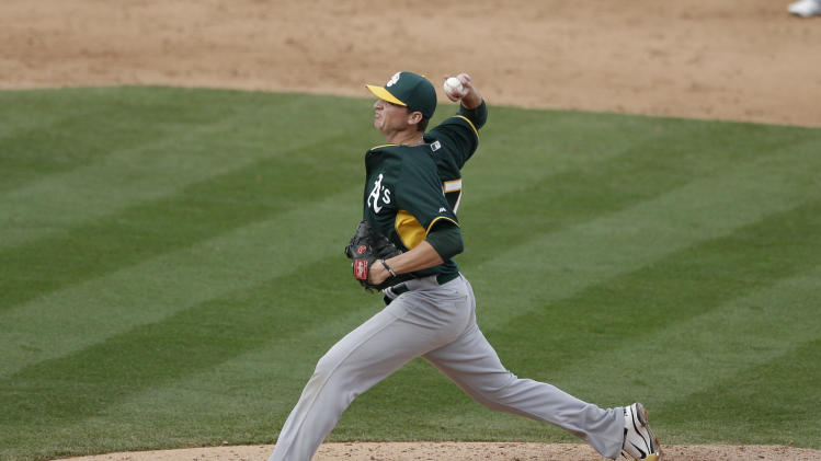 Oakland Athletics pitcher Seth Frankoff pitches to an Arizona Diamondbacks batter during the ninth inning of an exhibition spring training baseball game Thursday, March 6, 2014, in Scottsdale, Ariz. (AP Photo/Gregory Bull)