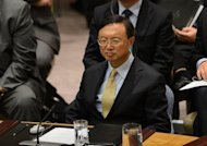 "<p>Chinese Foreign Minister Yang Jiechi attends a UN Security Council meeting at the UN HQ in New York in September. Beijing gave no official reason for sending only their deputies to global financial meetings in Japan this week, with Yang telling reporters in Beijing only that ""the arrangement of the delegation for the meeting was completely appropriate"".</p>"