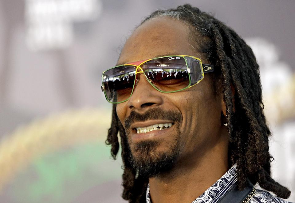 Rapper Snoop Dogg arrives for the BET Hip Hop Awards, Saturday, Sept. 28, 2013, in Atlanta. (AP Photo/David Goldman)