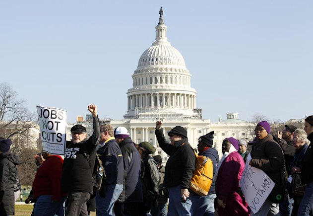 Demonstrators chant for jobs outside on Capitol Hill in Washington, Thursday Dec. 8, 2011. Dozens of activists protesting the U.S. government's failure to help the unemployed are marching to the Capitol to pray for and shout at members of Congress _ above all, the leader of the House, Speaker John Boehner. (AP Photo/Jose Luis Magana)