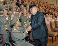 North Korean leader Kim Jong-Un (R) meets with military veterans in Pyongyang. Kim met with a senior Chinese official late Thursday to discuss closer ties with its main ally Beijing, state media said