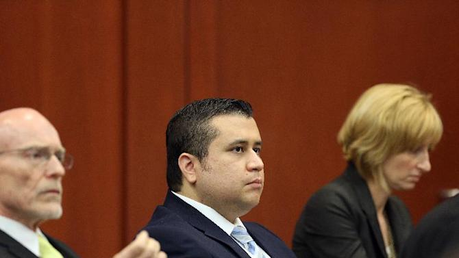 Defense attorneys Don West, left, and Lorna Truett, right, listen to testimony with George Zimmerman during day 13 in George Zimmerman's trial in Seminole circuit court in Sanford, Fla. Wednesday, June 26, 2013. Zimmerman has been charged with second-degree murder for the 2012 shooting death of Trayvon Martin. (AP Photo/Orlando Sentinel, Jacob Langston, Pool)