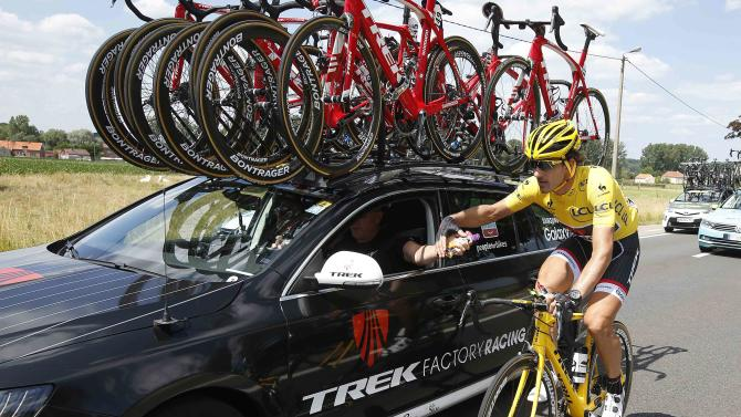 Race leader and yellow jersey holder Trek Factory rider Cancellara of Switzerland takes energy gel from his team car during the third stage of the 102nd Tour de France cycling race from Anvers to Huy