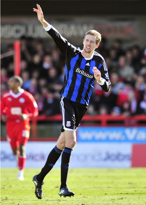 Stoke City's English striker Peter Crouch celebrates scoring their second goal during their FA Cup fifth round football match against Crawley Town at Broadfield Stadium in Crawley, England on February