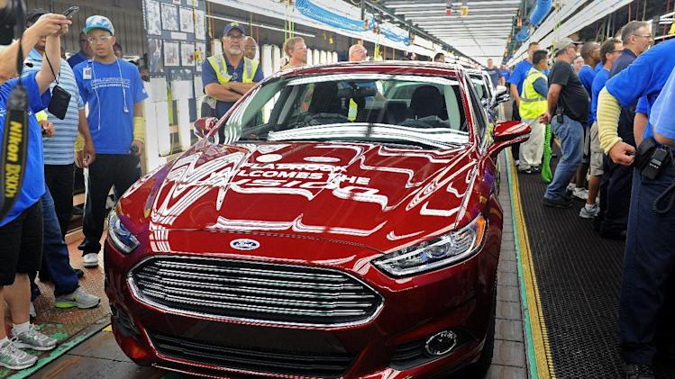 A new 2014 Ford Fusion is displayed on the line in Flatrock, Mich. on Thursday, Aug. 29, 2013. For the first time, Ford is making its Fusion sedan in the U.S. The company's Flat Rock, Mich., plant began making the Fusion on Thursday. (AP Photo/Detroit News, Charles V. Tines)