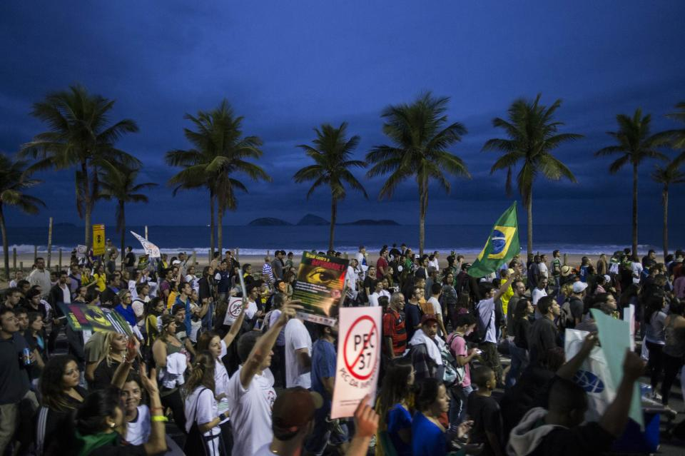 People march toward the home of Sergio Cabral, the governor of Rio de Janeiro state, to stage a protest in Rio de Janeiro, Brazil, Sunday, June 23, 2013. A wave of protests have shaken Brazil and pushed the government to promise a crackdown on corruption and greater spending on social services. (AP Photo/Felipe Dana)