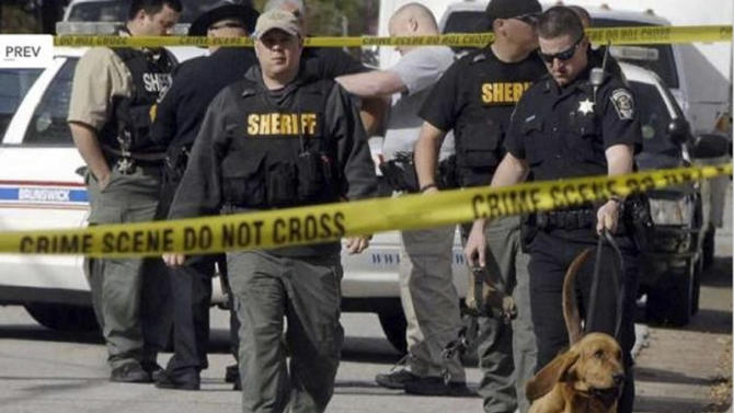 Authorities investigate the scene of shooting in Brunswick, Ga. on Thursday, March 21, 2013. A young boy opened fire on a woman pushing her baby in a stroller in a Georgia neighborhood, killing the 1-year-old boy and wounding the mother, police said. The woman, Sherry West, told WAWS-TV that two boys approached her and demanded money Thursday morning. Brunswick Police Chief Tobe Green said the boys are thought to be between 10 and 15 years old.(AP Photo/The Morning News, Terry Dickson)