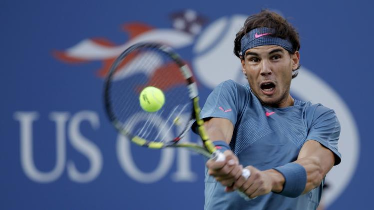 Nadal of Spain hits a return to Djokovic of Serbia in their men's final match at the U.S. Open tennis championships in New York
