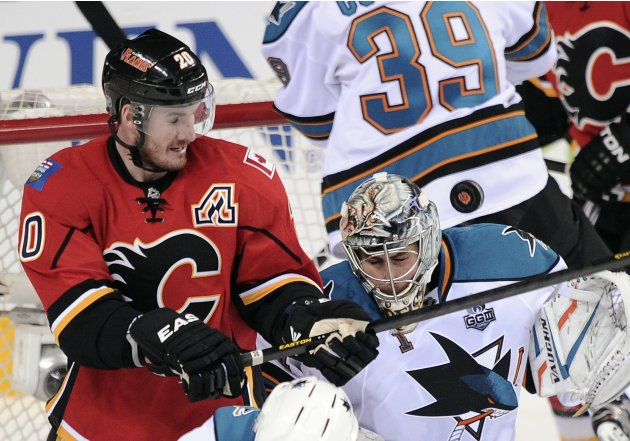 Calgary Flames' Glencross attempts to score against San Jose Sharks' goalie Greiss during the second period of their NHL hockey game in Calgary