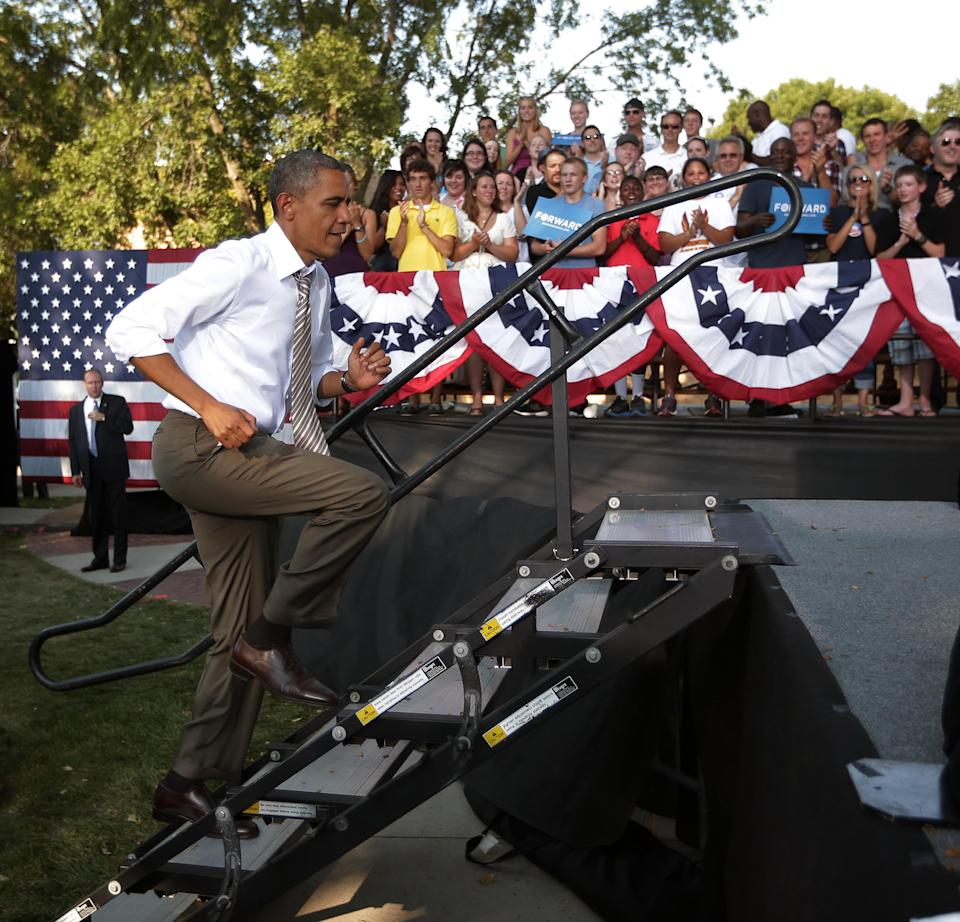 President Barack Obama runs up the stairs before speaking at a campaign event at Morningside College, Saturday, Sept. 1, 2012, in Sioux City, Iowa. (AP Photo/Pablo Martinez Monsivais)